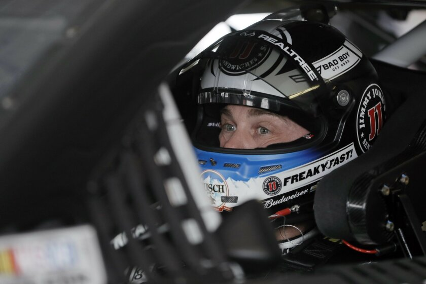 Kevin Harvick waits in his car for a practice session to start for Sunday's NASCAR Sprint Cup Series auto race, Friday, June 3, 2016, in Long Pond, Pa. (AP Photo/Matt Slocum)