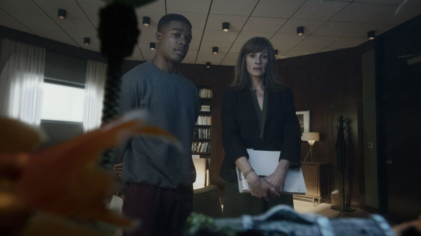 "Stephan James and Julia Roberts in ""Homecoming,"" a show streamed on Amazon's platform. The show's tale originated as a Gimlet podcast."