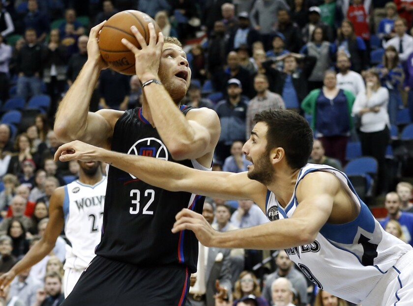 Clippers power forward Blake Griffin (32) eyes the basket as Timberwolves guard Ricky Rubio defends in the second half on Dec. 7.