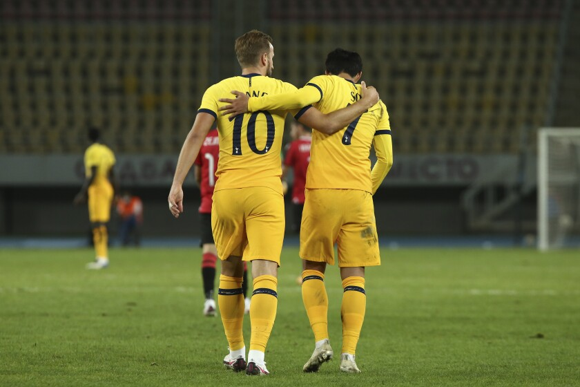 Tottenham's Harry Kane and his teammate Son Heung-min walk together after scoring the third goal of his team against Shkendija during a Europa League third qualifying round soccer match between Shkendija and Tottenham at the National Arena Todor Proeski in Skopje, North Macedonia, Thursday, Sept. 24, 2020. (AP Photo/Boris Grdanoski)