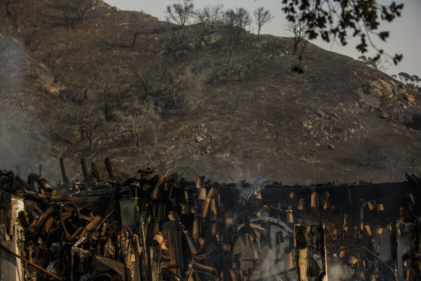 A view of the charred landscape and the falling Spanish tiles of a home that was destroyed by the Thomas fire in Montecito.