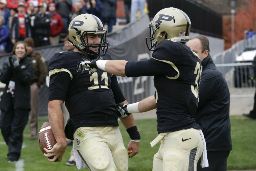 Purdue quarterback David Blough (11) celebrates his rushing touchdown with wide receiver Danny Anthrop (33) during the first half of an NCAA college football game against Nebraska in West Lafayette, Ind., Saturday, Oct. 31, 2015. (AP Photo/Michael Conroy)