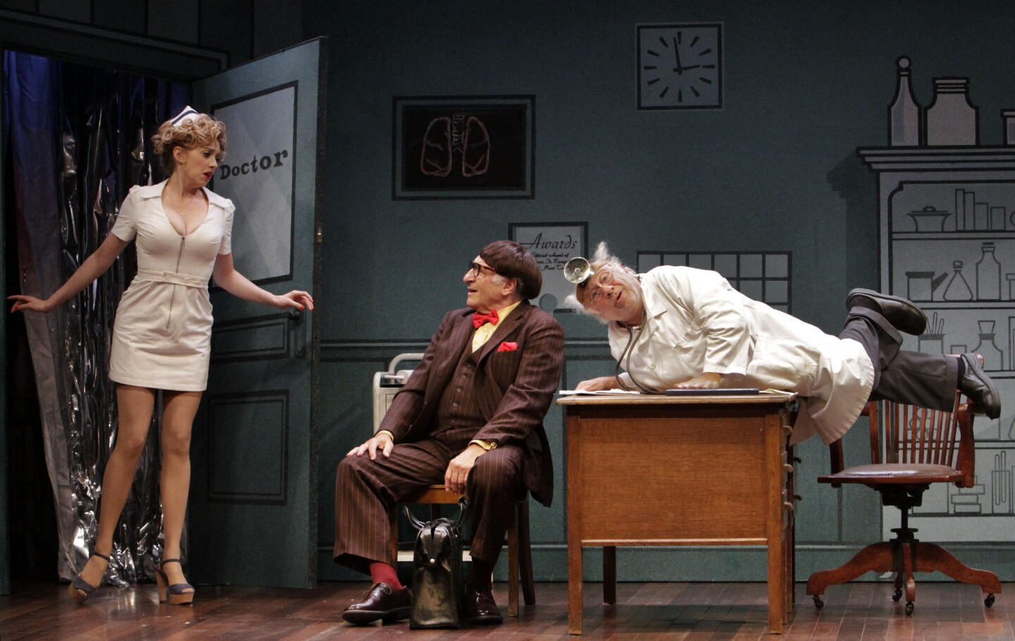 """Annie Abrams, Judd Hirsch, center; and Danny DeVito in a scene from the revival of Neil Simon's """"The Sunshine Boys"""" at the Ahmanson Theatre in Los Angeles."""