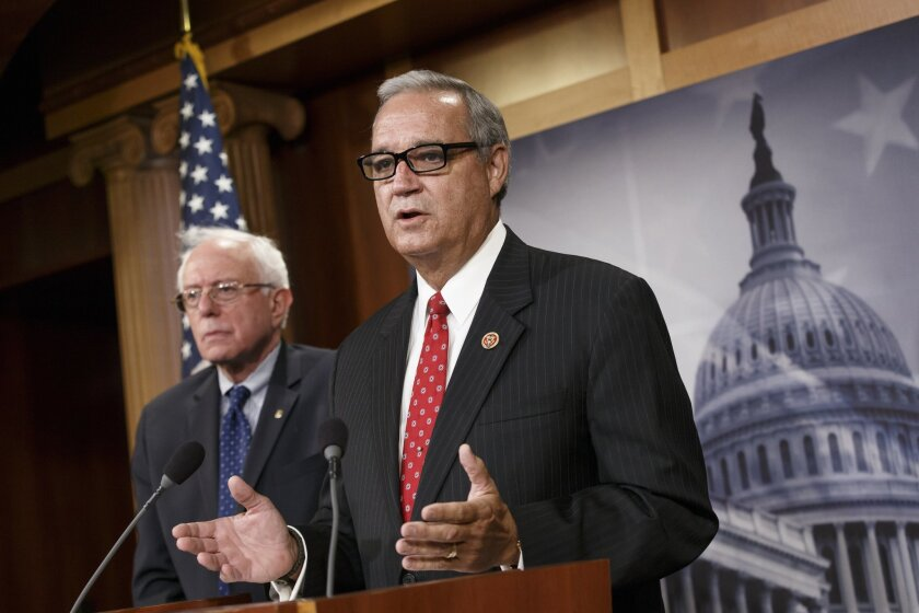 House Veterans' Affairs Committee Chairman Rep. Jeff Miller, R-Fla.,  joined by Senate Veterans' Affairs Committee Chairman Sen. Bernie Sanders, I-Vt., left,  speaks on Capitol Hill, in Washington, Monday, July 28, 2014, about a bipartisan deal to improve veterans' health care.  (AP Photo/J. Scott