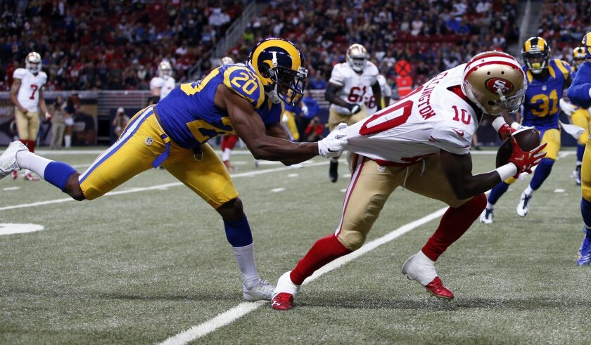 San Francisco 49ers wide receiver Bruce Ellington, right, is stopped by St. Louis Rams cornerback Lamarcus Joyner, left, after catching a pass during the fourth quarter of an NFL football game Sunday, Nov. 1, 2015, in St. Louis. (AP Photo/Billy Hurst)