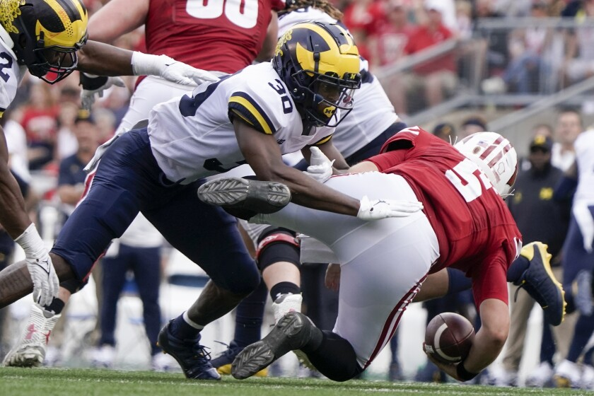 Michigan's Daxton Hill hits Wisconsin's Graham Mertz during the second half of an NCAA college football game Saturday, Oct. 2, 2021, in Madison, Wis. Mertz was hurt on the play and left the game. (AP Photo/Morry Gash)