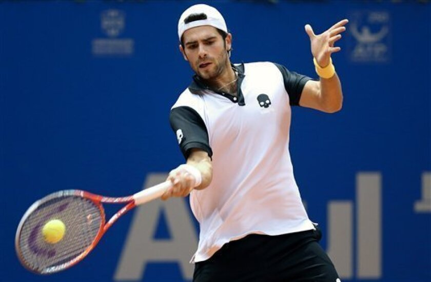 Italy's Simone Bolelli returns the ball to Argentina's David Nalbandian during a Brazil Open ATP tournament semifinal tennis match in Sao Paulo, Brazil, Saturday, Feb. 16, 2013. (AP Photo/Andre Penner)