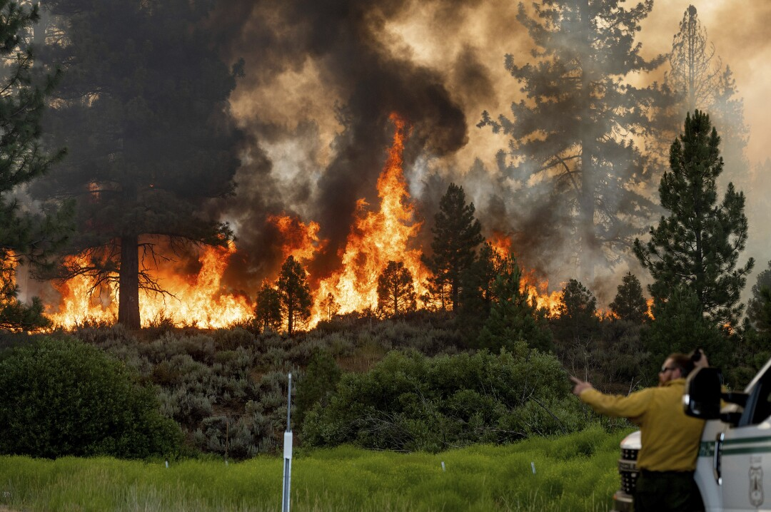 Firefighter Kyle Jacobson monitors the Sugar fire