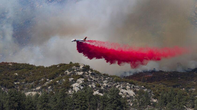 LAKE HEMET, CA - JULY 27, 2018: An air tanker drops fire retardant as the air assault on the Cranst