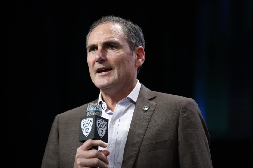 Pac-12 commissioner Larry Scott speaks at a news conference.