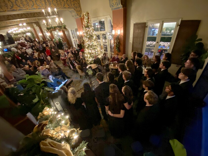 La Jolla Country Day School's Madrigal Singers perform at La Valencia Hotel's Christmas tree-lighting ceremony Dec. 5.