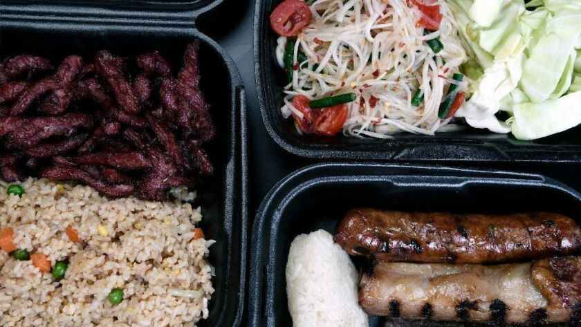 Laotian beef jerky with fried rice, papaya salad and a combo plate with sticky rice from Kra Z Kai's.
