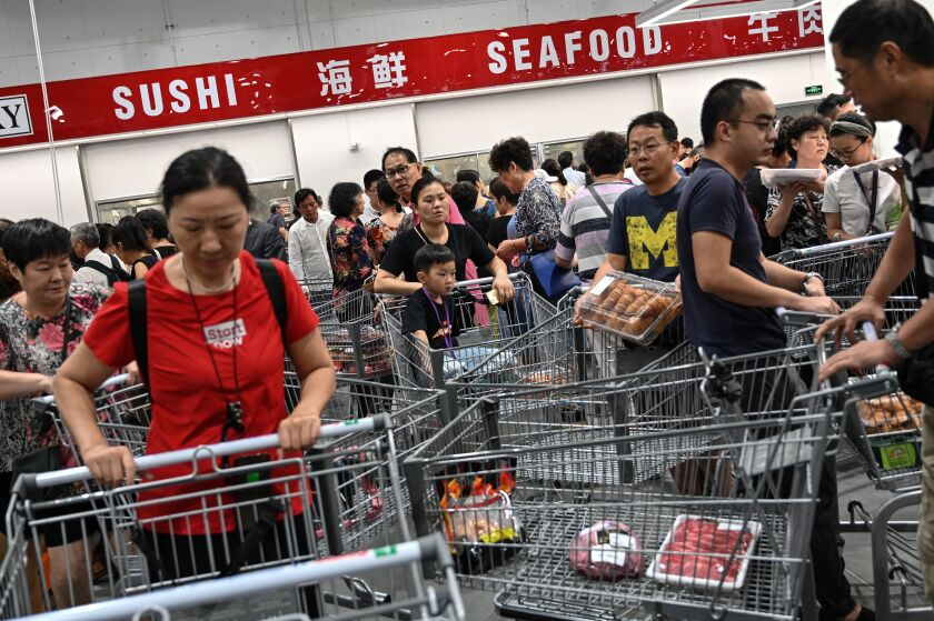 People visit the first Costco outlet in China.