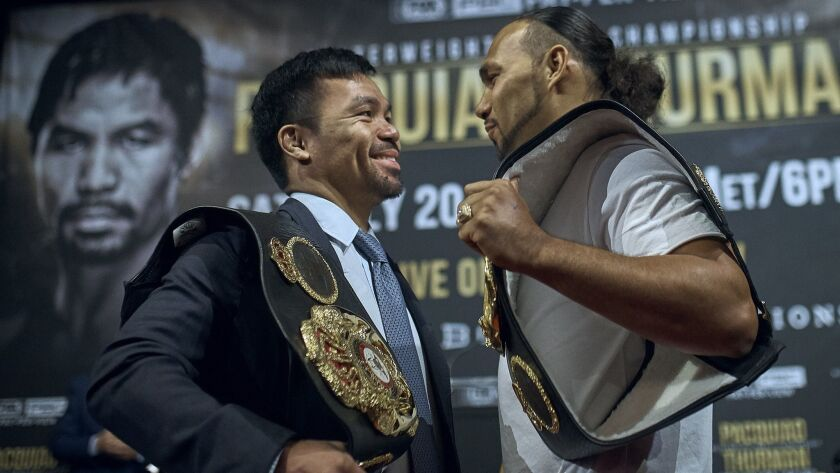 Manny Pacquiao, left, and Keith Thurman stand face to face during a news conference on Tuesday, May