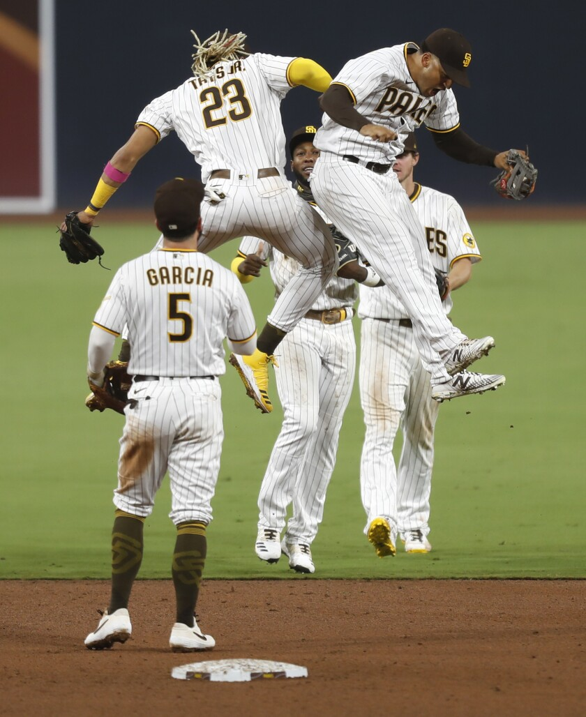 The Padres celebrate a 7-2 win over the Dodgers on Sept. 14 at Petco Park.