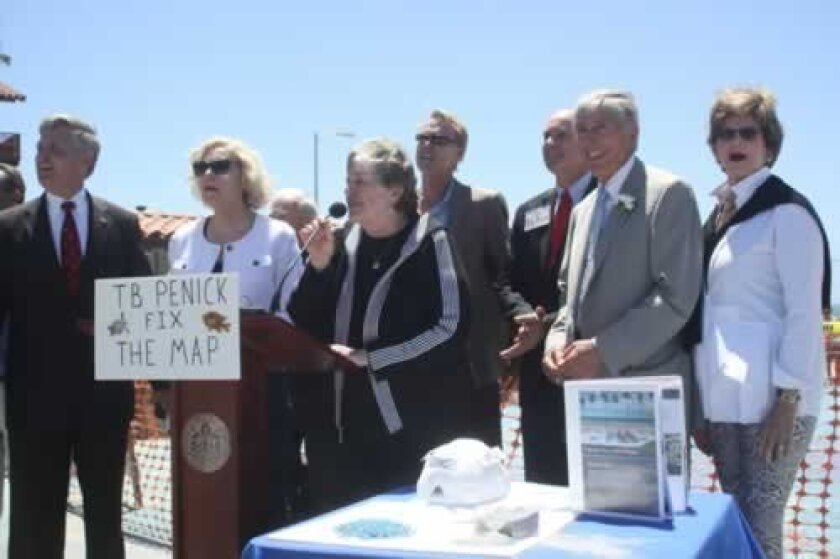 Officials, led by Mary coakley-Munk (center), gather to chant 'T.B. Penick, Fix The Map!' at a press conference announcing their lawsuit. From left, foreground: County Supervisor Dave Roberts, former County Supervisor Pam Slater-Price, Coakley-Munk, attorney Vincent Bartolotta and Friends of La Jolla Shores member Catharine Douglass.