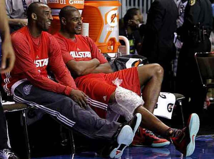 Lakers stars Kobe Bryant and Andrew Bynum share a laugh during a break at All-Star practice on Saturday in Orlando.