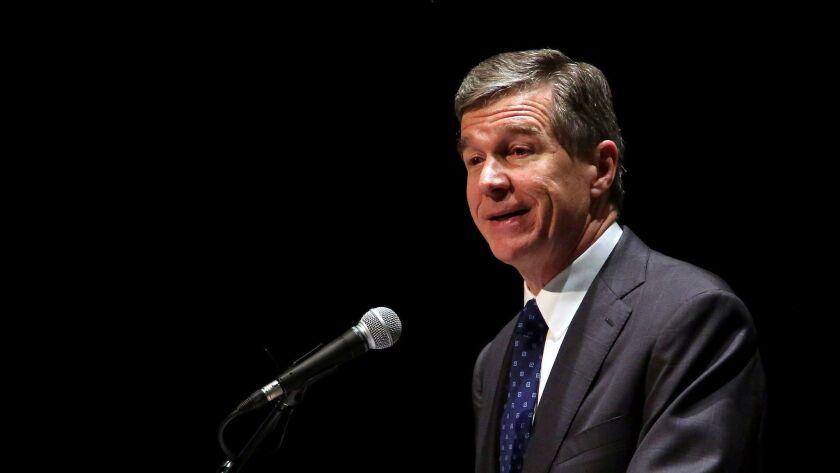 North Carolina Democratic Gov. Roy Cooper challenged a Republican-backed law that changed how elections are organized and managed in the state.