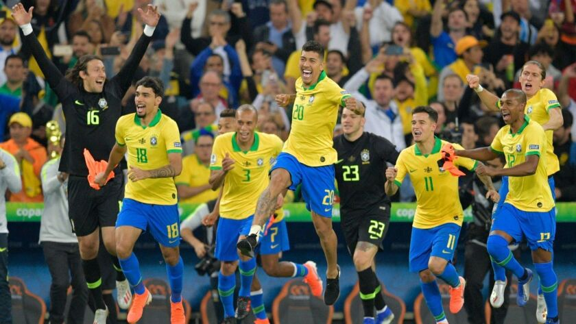 Brazil's players celebrate after defeating Peru to win the Copa America tournament at Maracana Stadium in Rio de Janeiro on Sunday.