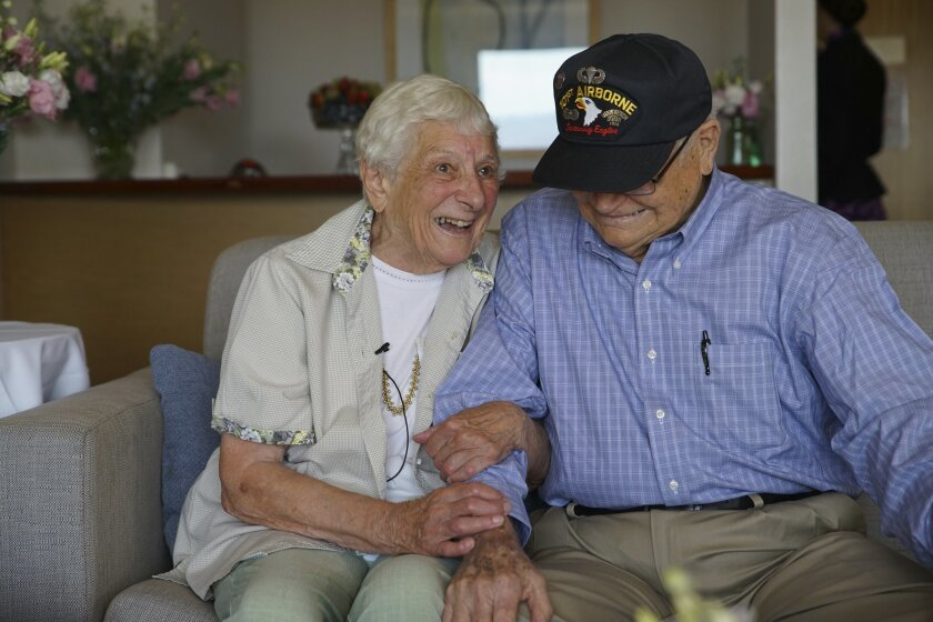 In this Wednesday, Feb. 10, 2016 photo released by Air New Zealand, World War II veteran Norwood Thomas, 93, from the U.S. reunites with his wartime girlfriend Joyce Morris of Australia, in Adelaide, Australia, after more than 70 years apart. Morris was a 17-year-old British girl and Thomas was a 2