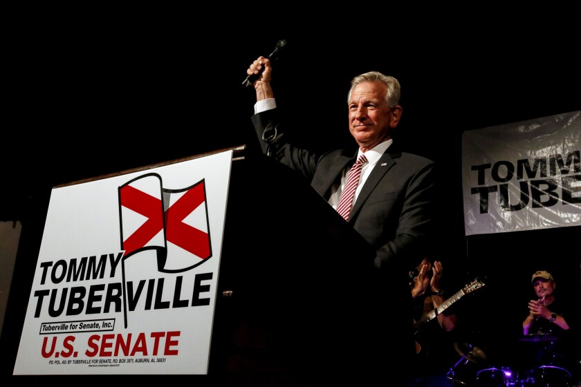 FILE- In this Tuesday, July 14, 2020, file photo, former Auburn coach, Tommy Tuberville, speaks to supporters after he defeated Senator Jeff Sessions in the runoff election in Montgomery, Ala. U.S. Sen. Doug Jones is outspending Tuberville in the home stretch of Alabama's Senate race. (AP Photo/Butch Dill, File)