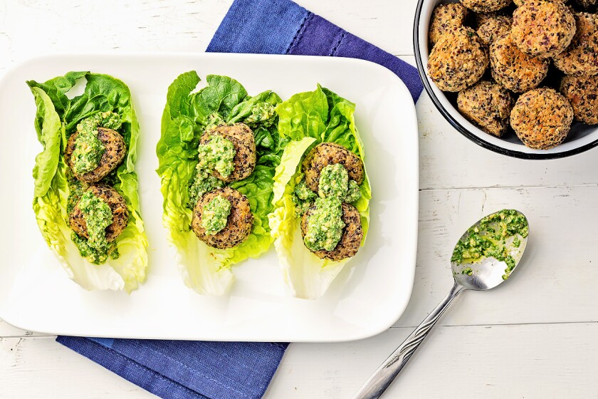 Quinoa balls topped with lemony walnut pesto and wrapped in beautiful gem lettuce.