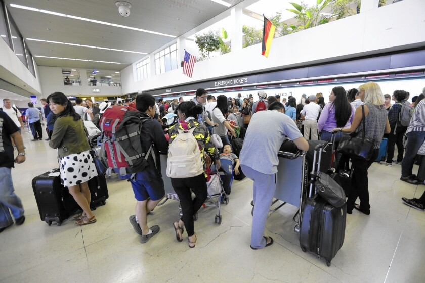 Passengers wait in long lines at LAX, which could see a significant rise in annual travelers by 2040.