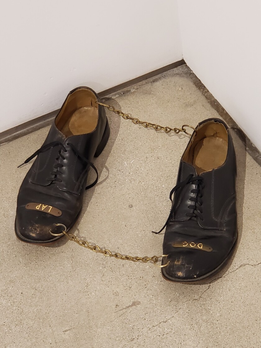 "Nayland Blake, ""Lap Dog,"" 1987; leather shoes, brass plates, chain"