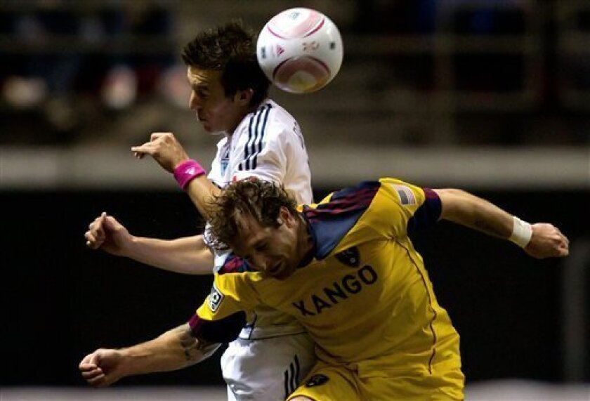 Vancouver Whitecaps' Jeb Brovsky, top, and Real Salt Lake's Cody Arnoux jump for the ball during second-half MLS soccer game action in Vancouver, British Columbia, on Thursday, Oct. 6, 2011. (AP Photo/The Canadian Press, Darryl Dyck)