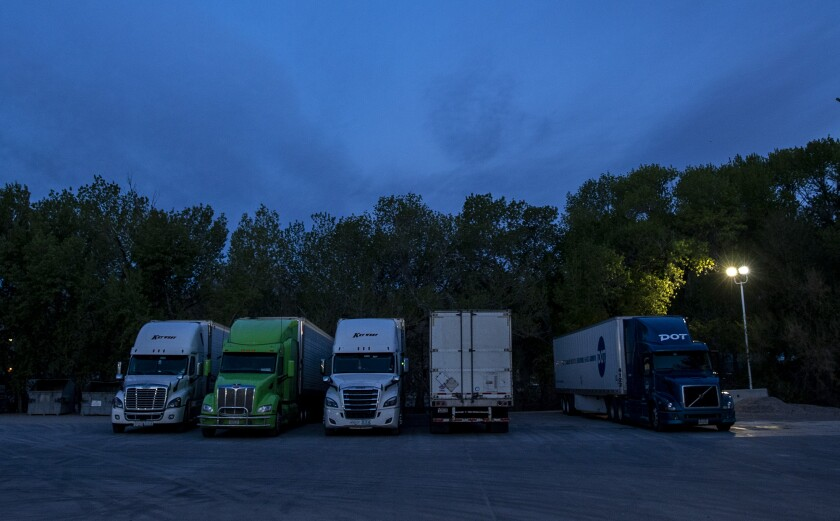 Truckers park for the night at the Sinclair gas station in Alamo, NV.