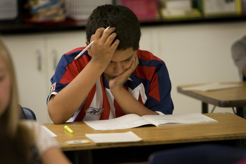A 6th-grader takes a standardized test at Pershing Middle School in 2010