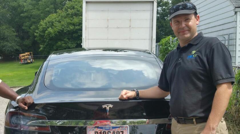 Joshua Brown with his Tesla