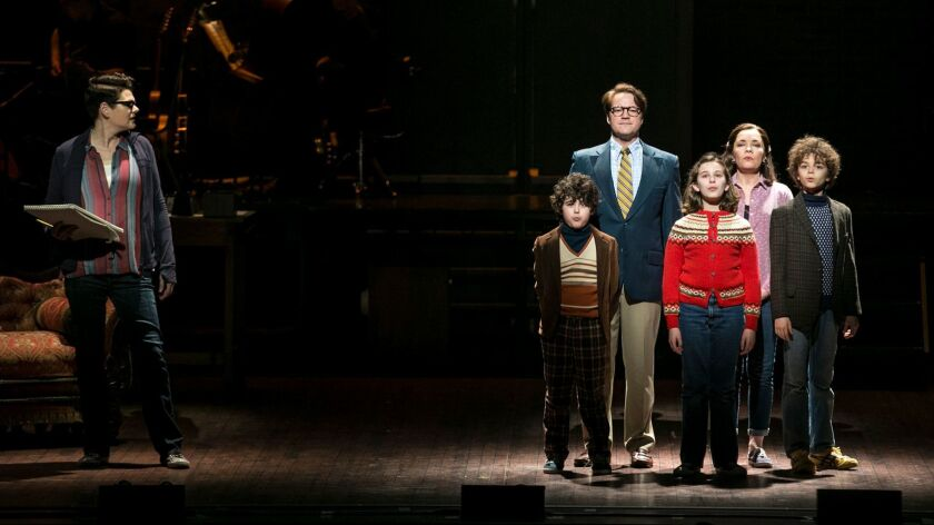 "Kate Shindle as Alison Bechdel looks toward an earlier version of her family, played by, from left, Lennon Nate Hammond, Robert Petkoff, Alessandra Baldacchino, Susan Moniz and Pierson Salvador in the touring production of ""Fun Home."""