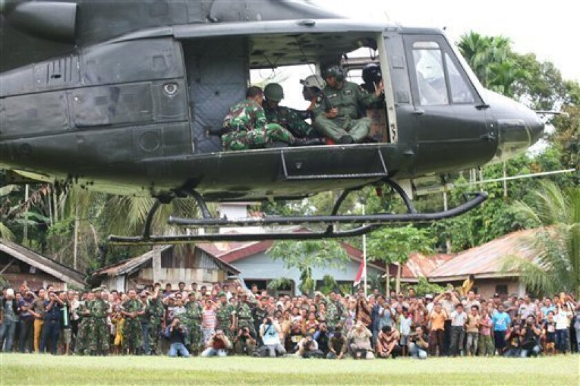 A helicopter carrying a rescue team aboard takes off to evacuate plane crash victims in Bahorok, Nort Sumatra, Friday, Sept. 30, 2011. Rescuers trying to reach a plane that crashed in the mountains of western Indonesia said Friday there still may be survivors, after spotting the wreckage intact in the trees with one of its doors opened.(AP Photo/Binsar Bakkara)