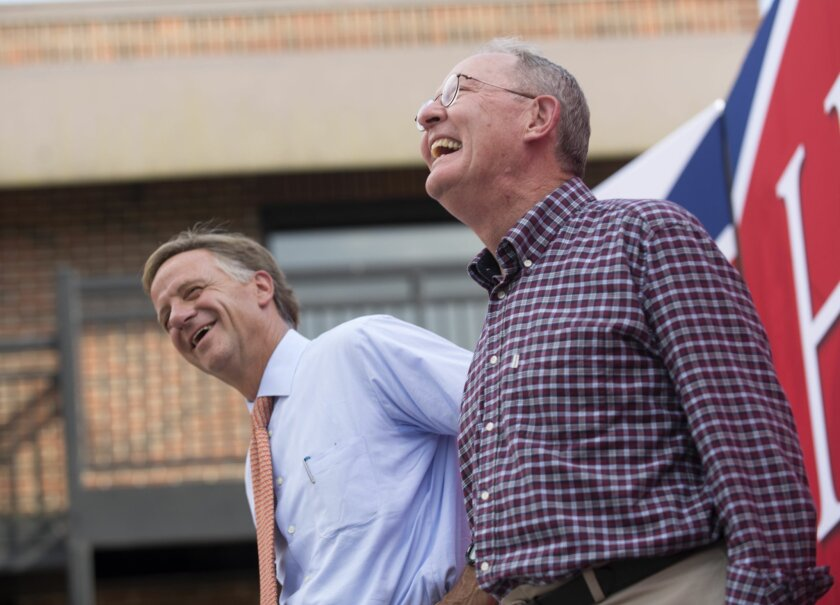 Gov. Bill Haslam, left, and U.S. Sen. Lamar Alexander react to remarks by U.S. Rep. John J. Duncan Jr. during a get out the vote rally Wednesday, Aug. 6, 2014, in Knoxville, Tenn. Alexander is being challenged by state Rep. Joe Carr and Memphis radio station owner George Flinn for his senate seat. (AP Photo/Knoxville News Sentinel, Paul Efird)