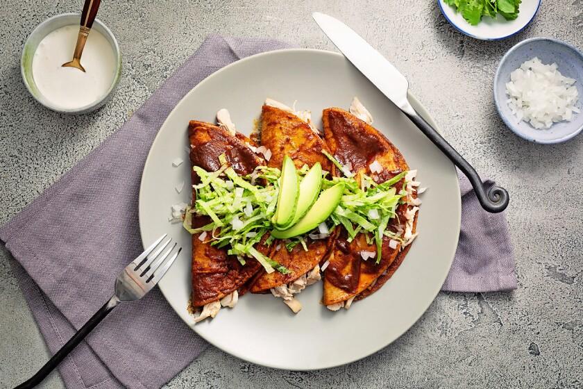 Chicken enchiladas with a super easy enchilada red sauce.