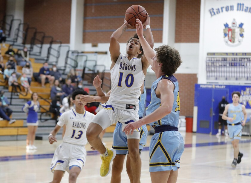 Fountain Valley's Roddie Anderson sinks a running jumper during a Wave League basketball game against Marina on Friday.