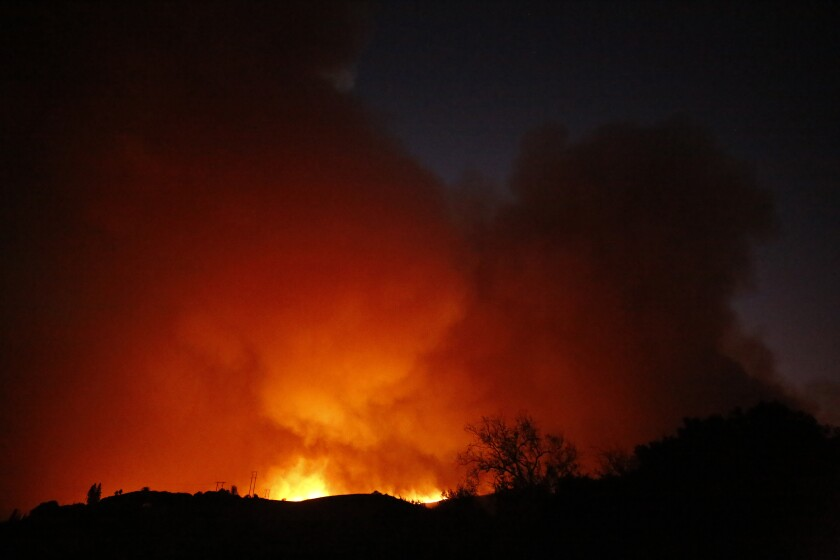 Flames from the Alisal fire light up the night sky.