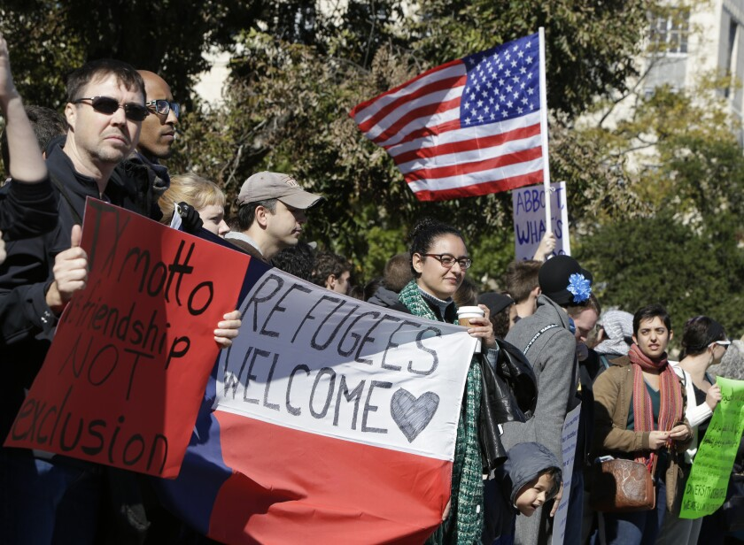 Members of the Syrian People Solidarity Group demonstrate Nov. 22 in Austin. The group was protesting comments by Texas Gov. Greg Abbott, who said he does not want Syrian refugees in the state.