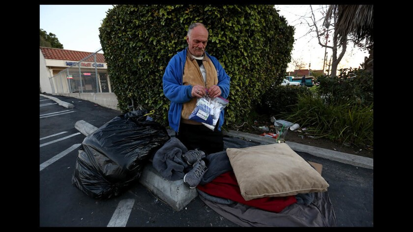 John Wagner holds a City Net care package given to him in Costa Mesa.