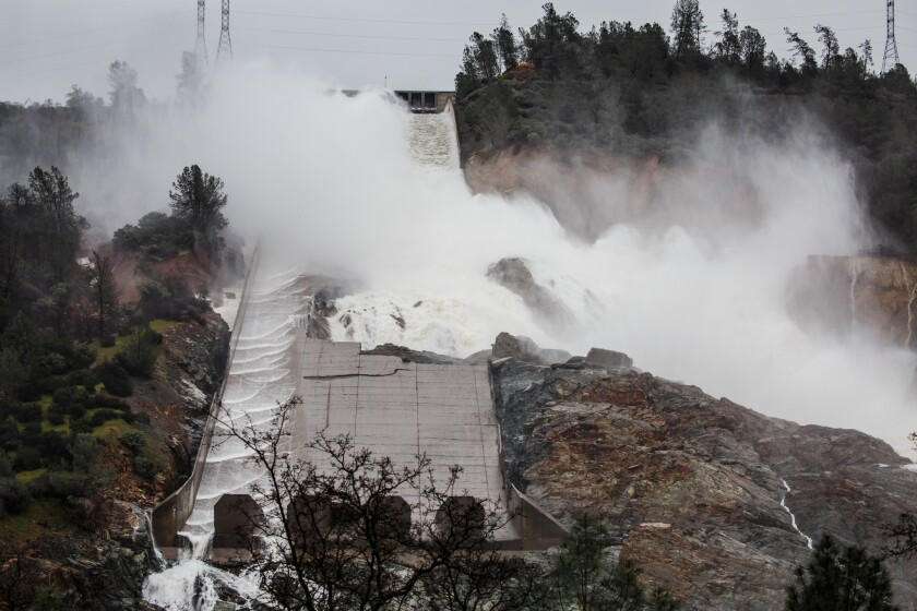 Water is released down a damaged spillway at Oroville Dam earlier this year.