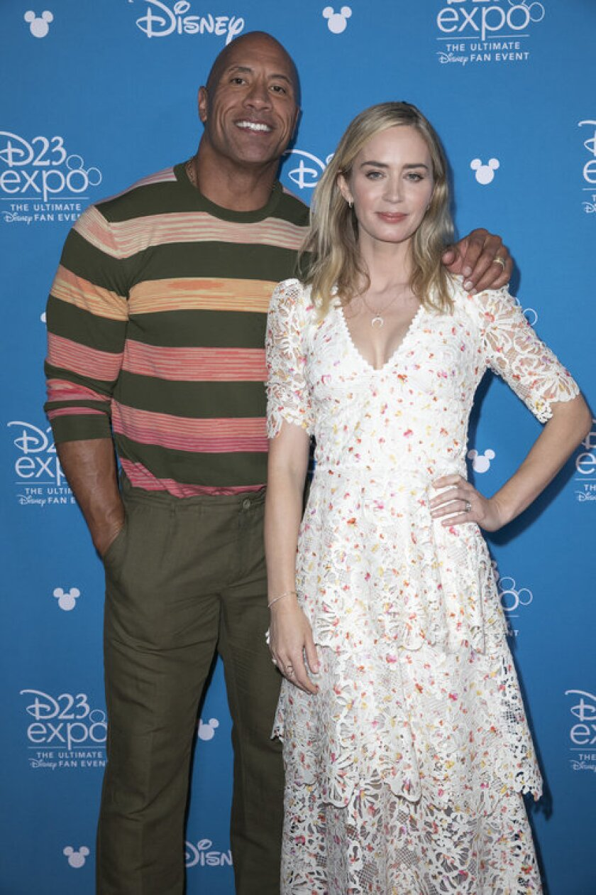 Dwayne Johnson and Emily Blunt at the 2019 D23 Expo.