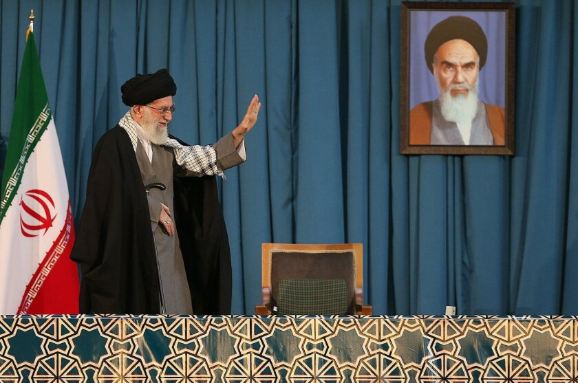 Ayatollah Ali Khamenei, Iran's supreme leader, waves on Saturday to the crowd attending the celebrations of the Persian New Year in the northeastern city of Mashhad.