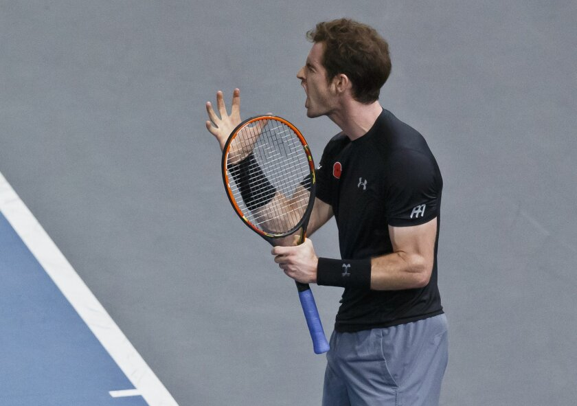 Britain's Andy Murray reacts after losing a point against France's Richard Gasquet during their quarterfinal match of the BNP Masters tennis tournament at the Paris Bercy Arena, in Paris, France, Friday, Nov. 6, 2015. (AP Photo/Michel Euler)