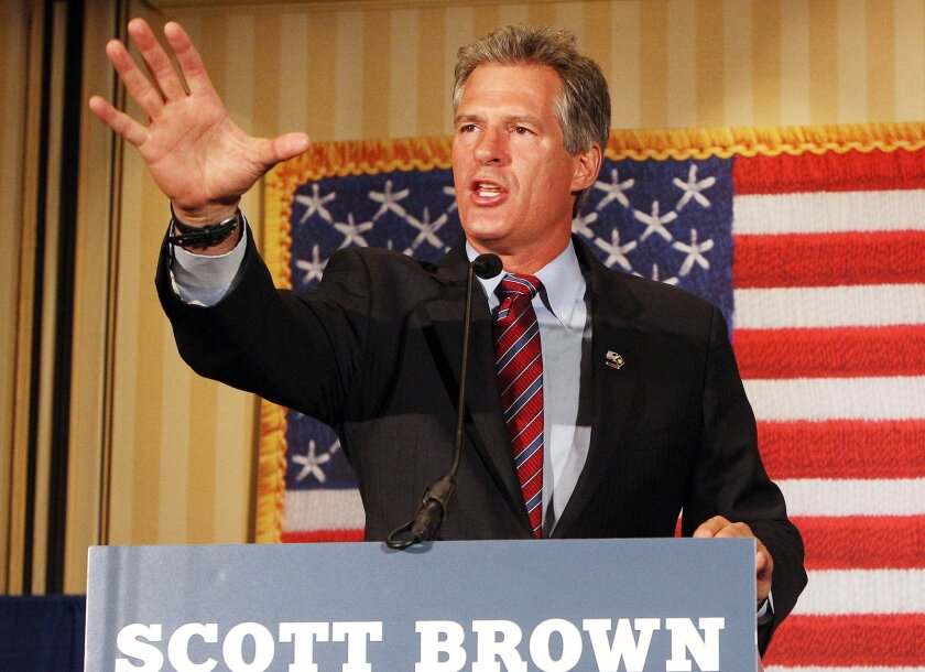 Scott Brown, a former U.S. Senator from Massachusetts, speaks to supporters after winning New Hampshire's Republican U.S. Senate primary on Tuesday Sept. 9, 2014 in Concord, N.H. Brown will face incumbent Democrat Jeanne Shaheen in the general election in November. (AP Photo/Jim Cole)