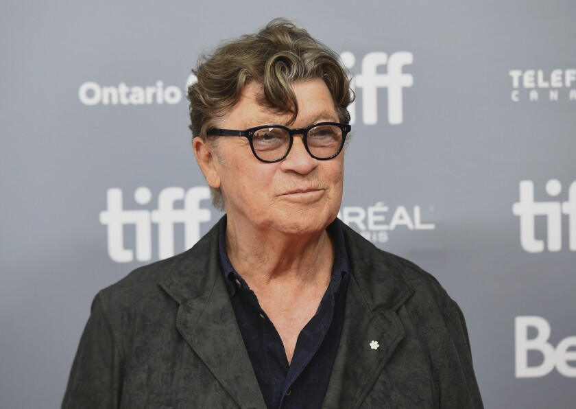 """FILE - This Sept. 5, 2019 file photo shows Robbie Robertson at a press conference for """"Once Were Brothers: Robbie Robertson and The Band"""" at the Toronto International Film Festival in Toronto. Robertson has a new album """"Sinematic,"""" has scored the upcoming Martin Scorcese film """"The Irishman,"""" is writing a second volume of his memoir """"Testimony"""" and is celebrating the 50th anniversary of The Band's self-titled album with a new box set. (Photo by Chris Pizzello/Invision/AP, File)"""
