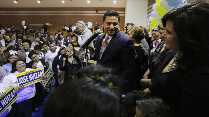 Los Angeles City Councilman Jose Huizar acknowledges his wife, Richelle Huizar, at a 2015 election night event at Bishop Mora Salesian High School.