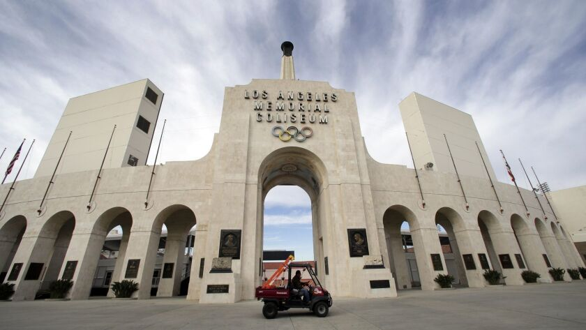 FILE - This Jan. 13, 2016 file photo shows the peristyle of the Los Angeles Memorial Coliseum in Los