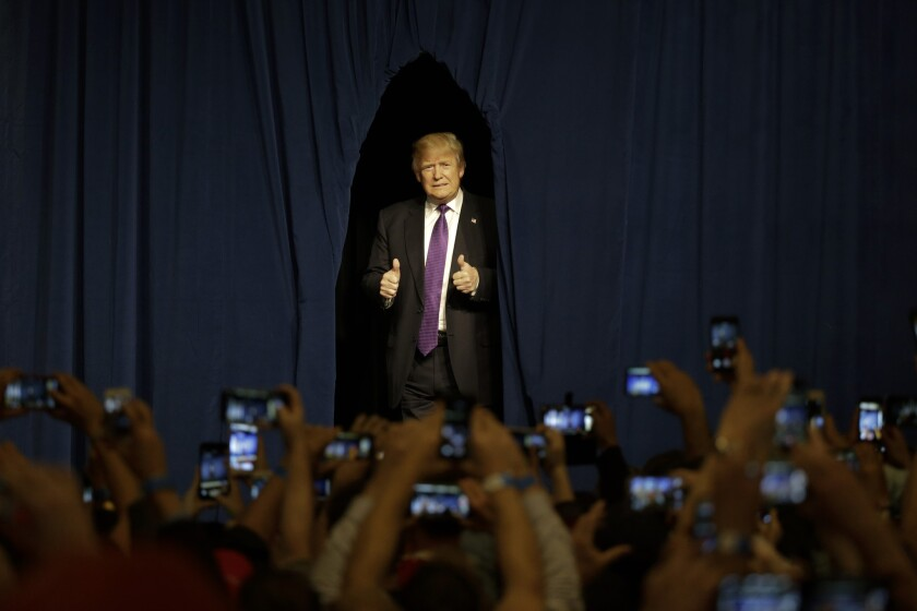 Republican presidential candidate Donald Trump arrives for a caucus night rally Tuesday in Las Vegas.