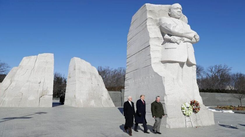President Trump and Vice President Mike Pence, escorted by acting Interior Secretary David Bernhardt, visit the Martin Luther King Jr. Memorial on Monday.